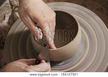 Close-up of the hands of a ceramist working in his potter wheel.Ceramist workout