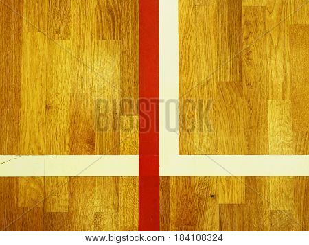 Red Corner Line. Worn Out Wooden Floor Of Sports Hall With Colorful Marking Lines