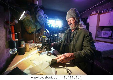 Man Sewing Fabric