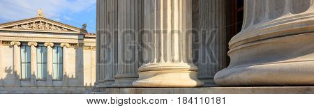 Greek Marble Pillars Infront Of A Classical Building
