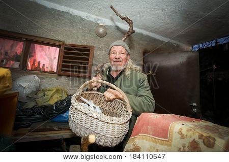Old Man Holding Basket