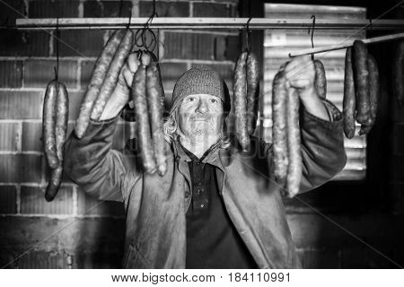 Old Man With Sausages Bw