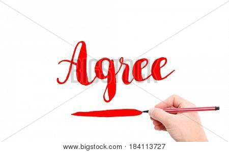 The word of Agree written by hand on a white background