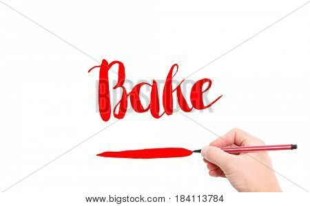The word of Bake written by hand on a white background