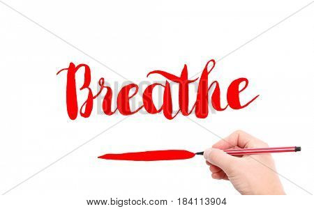 The word of Breathe written by hand on a white background