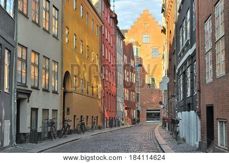 Copenhagen Denmark. Beautiful cozy street of the Old Town in a sunny summer morning