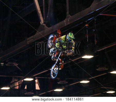 St. Petersburg Russia - 15 April, Biker in the jump,15 April, 2017. International Motor Show IMIS-2017 in Expoforurum. Moto show at the St. Petersburg moto salon.