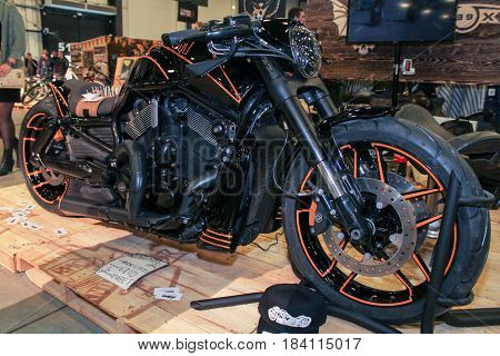 St. Petersburg Russia - 15 April, A powerful black bike with an orange stroke,15 April, 2017. International Motor Show IMIS-2017 in Expoforurum. Motorcycles and motoconcepts presented at St. Petersburg Motor Show.