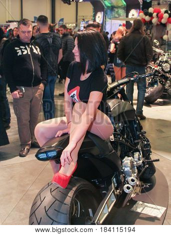 St. Petersburg Russia - 15 April, A model sitting motobike,15 April, 2017. International Motor Show IMIS-2017 in Expoforurum. Models on motorcycles presented at the motor show.