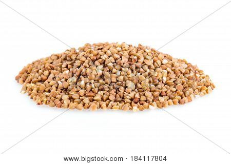 Heap of buckwheat grain on a white background