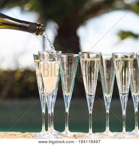 Many Glasses Of Champagne Or Prosecco Near Resort Pool In A Luxury Hotel. Pool Party.