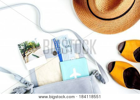 journey planning with tourist outfit and tickets, hat, shoes with passport on white table background top view