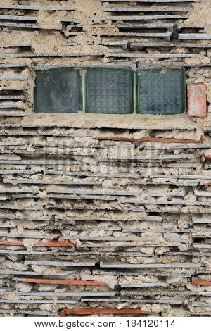 Fragment Of Wall, Created From Clay And Tile Laid In Layers And Opaque Window, Outdoor, Ukraine