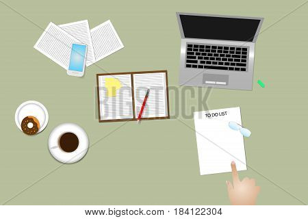Office desk top view with supplies coffee cup and donut. Finger is pointing paper with time management method To Do List