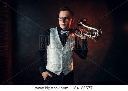 Male jazz man posing with saxophone