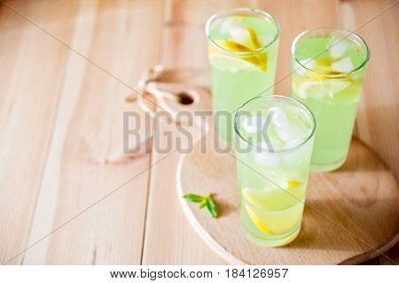 Mojito Cocktail Or Lemonade With Lime, Mint And Ice Cubes. Traditional Summer Refreshing Drink.