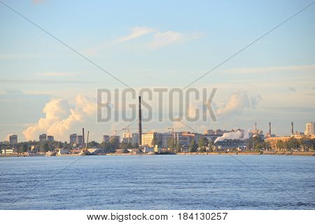 The Neva river and the industrial outskirts of St. Petersburg at evening Russia.