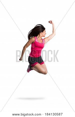 Vital and athletic girl jumps nimbly very high