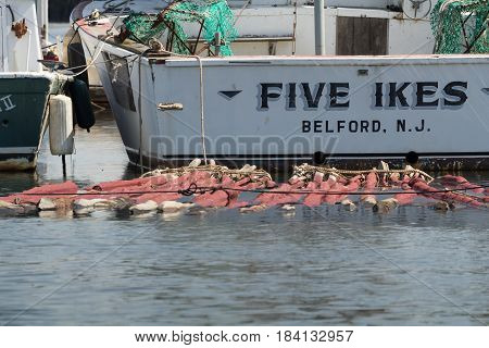 BELFORD NEW JERSEY - April 11 2017: The Five Ikes fishing boat is docked at the Belford Seafood Cooperative