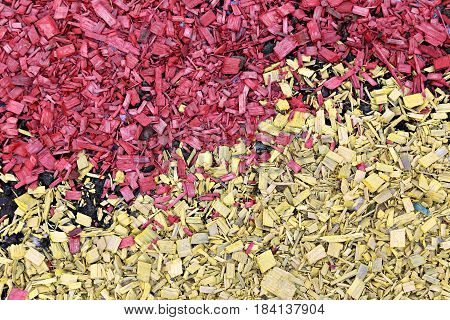 Background of painted wood chips on the soil in the garden