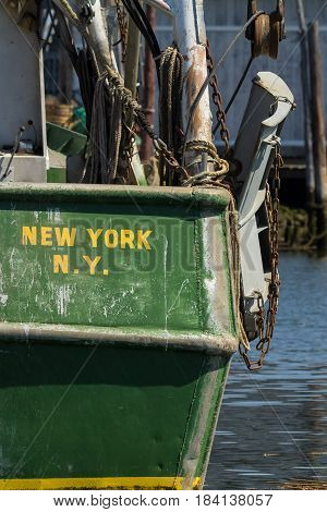 BELFORD NEW JERSEY - April 11 2017: Commercial fishing boats are docked at the Belford Seafood Cooperative