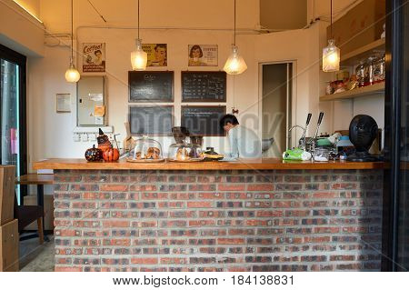HONG KONG - OCTOBER 25, 2015: interior of a coffee shop at Kennedy Town. Kennedy Town is at the western end of Sai Wan on Hong Kong Island