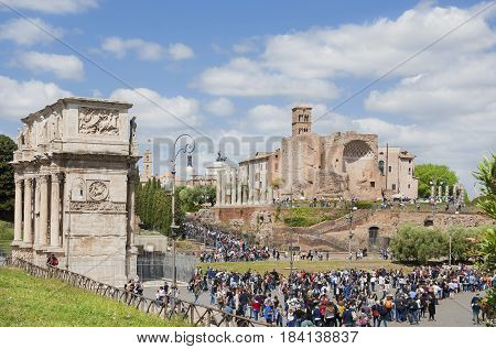 ROME, ITALY - APRIL 23: Tourists visit Rome central archaeological area with Arch of Constantine and ancient Temple of Venus and Roma ruins APRIL 23, 2017 in Rome, Italy