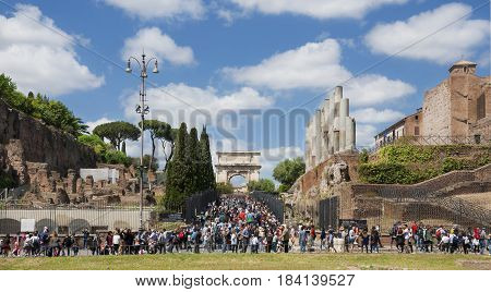ROME, ITALY - APRIL 23:Tourist enter Roman Forum through ancient Arch of Titus in Rome central archaeological area APRIL 23, 2017 in Rome, Italy
