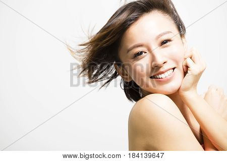smiling young asian Woman with hair motion