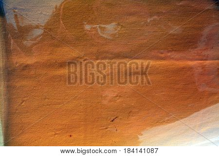 Abstract background image. Cellophane gel lays over a white table cloth for a unique colored and textured abstract background. Room for text or images.
