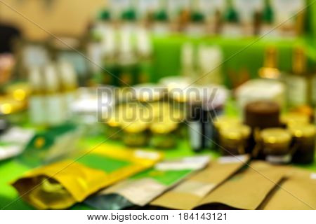 Blurred view of different cosmetics in modern shop