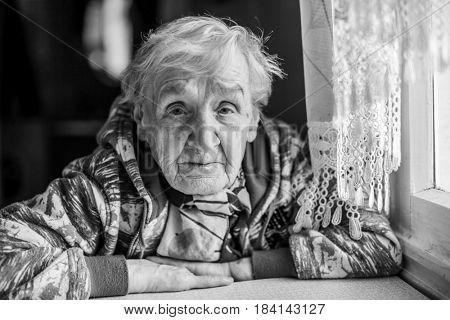 Portrait of an elderly woman. Grandma, black-and-white photo.