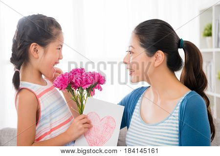 Woman Touch And Pinching Little Girl's Cheek