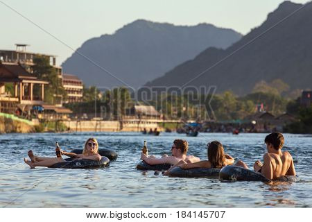 Vang Vieng, Laos - January 21, 2017: Tourist enjoy tubing in Song River at Vang Viang, Laos.