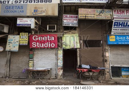 DELHI INDIA-JUN 17 : sleeping person in front of shop in morning at chandni chowk this area is in old delhi that is famous place of Delhi on june 17 2015 india