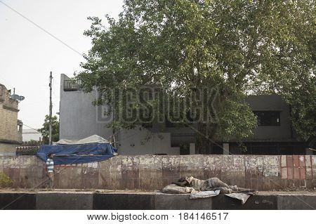 DELHI INDIA-JUN 18 : tramp man sleep on middle road at Kamla market near new delhi railway station tramp person live everywhere in public place in Delhi on june 18 2015 india