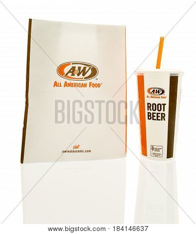 Winneconne WI - 23 April 2017: An A&W paper bag paper bag with drink on an isolated background.