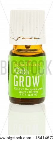 Winneconne WI - 25 April 2017: A bottle of Oola grow Young Living oil on an isolated background.