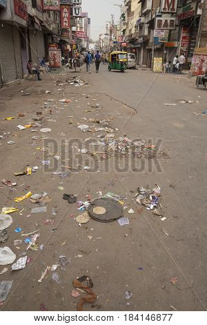 DELHI INDIA-MAR 29 : litter and dirty street in main bazar paharganj. there are many hotel in this street in delhi on march 29 2015 india