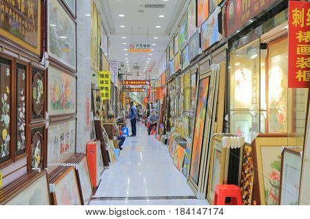 GUANGZHOU CHINA - NOVEMBER 13, 2016: Unidentified people visit art shops on Cultural street. Cultural street is famous for Chinese art shops.
