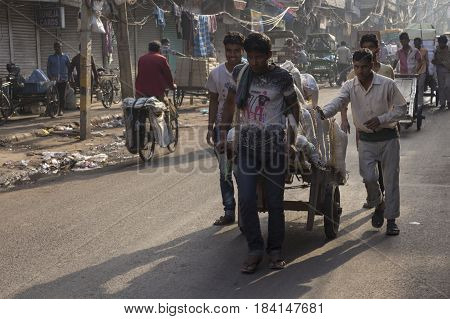 DELHI INDIA - APR 1 : worker transport goods by pushcart in chawri bazar. pushcart is popular vehicle in market of delhi on april 1 2015 india