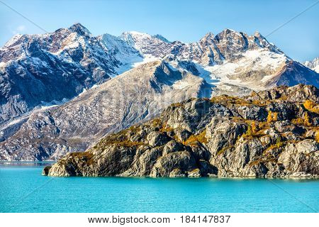 Alaska cruise travel. Glacier Bay National Park, Alaska, USA. Nature landscape of alaska mountain peaks and turquoise glacier water.