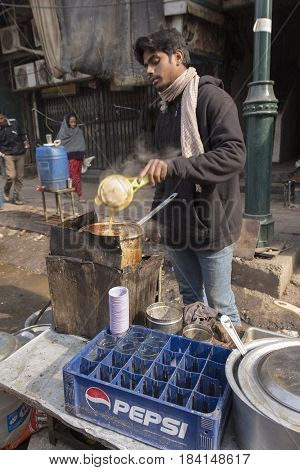 DELHI INDIA - DEC 20 : making of tradition india tea in street stall at chandni chowk in delhi on december 20 2014 india. india tea or chai is popular drink in india