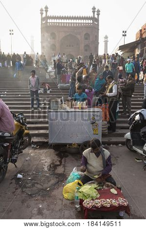 DELHI INDIA - DEC 20 : street market in front of jama masjid in old delhi. jama masjid is biggest masjid of delhi on december 20 2014 india