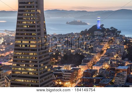 Dusk over Telegraph Hill, Alcatraz Island and San Francisco Bay from the Financial District. San Francisco, California, USA.