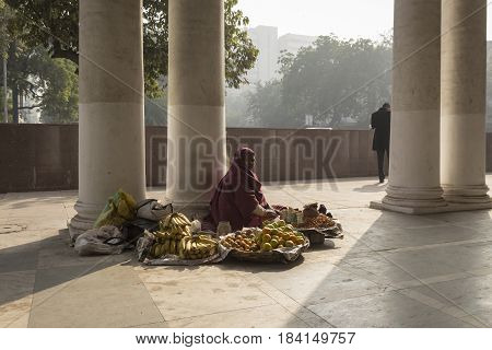 DELHI INDIA-DEC 25 : street fruit stall in Connaught Place. There are many sell stall in this area. Connaught Place is shopping center in center delhi on december 25 2014 india