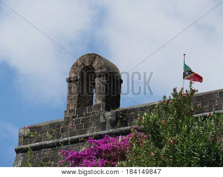 Bell Tower at Brimstone Hill Fortress, St. Kitts A tower with bell at the entrance to the Brimstone Hill Fortress in St. Kitts, West Indies