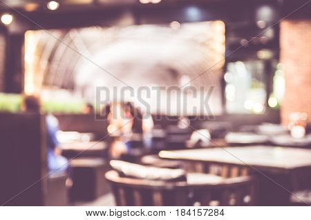 Abstract Blurred Background : People Dinning At Restaurant With Bokeh Light