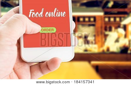 Hand Holding Mobile With Order Food Online With Blur Restaurant Background, Food Online Business Con