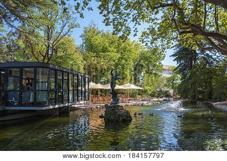 Avignon, France, September 9, 2016: Restaurant in the English-style city park located in the center of the city Avignon on the Rocher des Doms